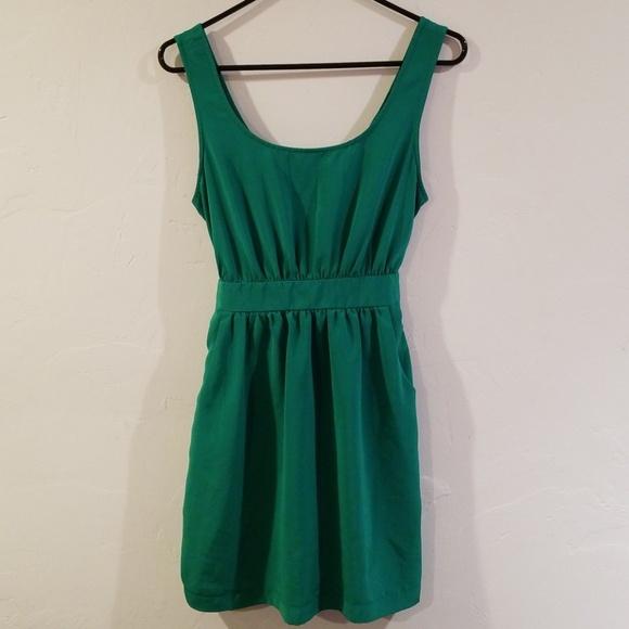 XXI Silky green dress peekaboo back and pockets